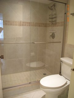 MB Shower separated by door from vanity area