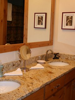 double sinks at vanity, upscale plumbing fixtures and plenty of outlets!