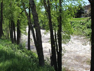 Spring/Summer view of Eagle River from virtually every window of home