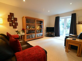The Living Room at Bluebell Cottage is stylish and offers access to the patio