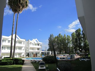 LAK, lovely Port de Pollenca, Habitat private. View to garden and pool.