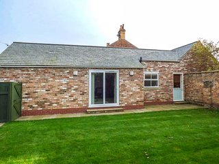 THE LODGE AT BOULTON HOUSE, ground floor barn conversion, garden with patio, in