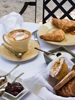 an italian  cappuccino and a croissant as ideal starters for a great day