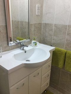 Family Bathroom - Basin with built in cupboard under & wc (not shown)