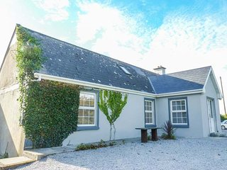 BLUEBELL COTTAGE, open plan living area, multi-fuel stove, ground floor, Kilrush