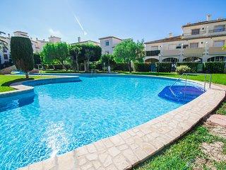 Casa semiadosada con jardín y piscina 500 m de la playa, Javea