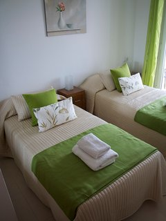 Bedroom 2, arranged with twin beds.