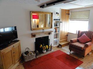 Sitting room with log burner. TV and DVD
