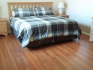 Master bedroom with wooden flooring