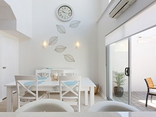 Light, bright and airy.  Dining area opens on to the rear courtyard.