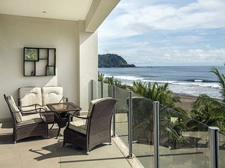 3 beds, 3 en suite baths, each with access to balcony & beach views!