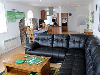 Open plan living with flexible bed arrangement overlooking Stornoway Harbour