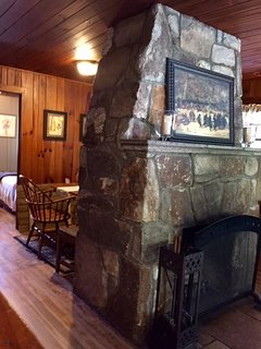 You can see the diningroom peaking out from behind the riverstone fireplace.