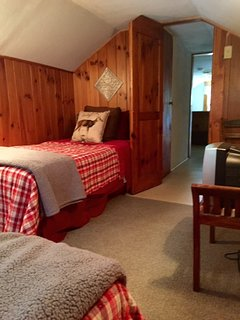Cozy upstairs area with twin beds