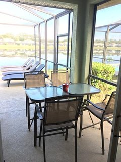 Enclosed patio lanai with fan, new lounge chairs (cushions available)