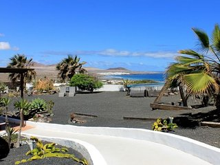 Garden apartment with private garden and stunning sea views of Famara beach