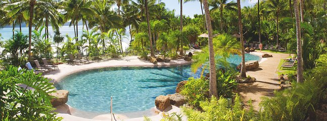Beach-side lagoon pool and heated spa, set among the manicured gardens.