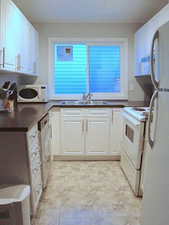 Bright kitchen full of amenities