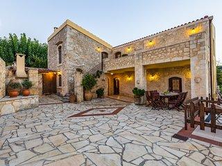 Facade of the villa, outdoor dining area