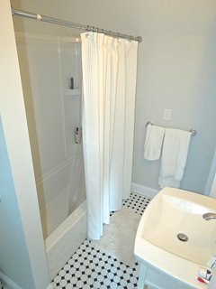 The full bath off the bedrooms has a tub/shower combination