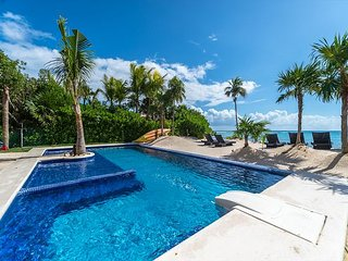 New 2nd Floor beachfront condo with Pool, Caribbean View, Wifi and AC.