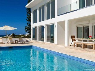 Luxury 4 bedroom contemporary villa superbly located on the water-front, Blowing Point
