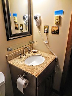 Master bathroom with beautiful vanity and hairdryer!