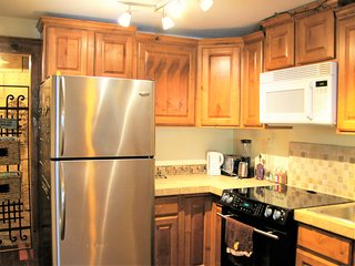 Enjoy the fully stocked kitchen with a range, dishwasher, microwave, blender. Everything you need.