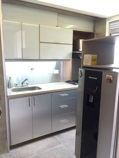 Fully funtional kitchen. With Fridge/freezer, stove, microwave, toaster, coffeemaker, blender & more