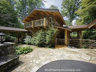 Ensconced by lavish trees and beautiful landscaping, this multi-million dollar custom built home sets the standard for luxury mountain living.