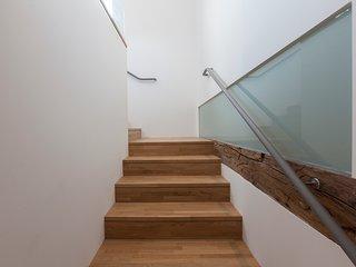 Escalera de acceso al alojamiento