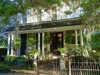 Two story Edwardian home with columned porch and entry to a beautiful foyer.