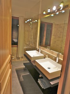 Master bedroom's en-suite bathroom with bidet, toilet and spacious open shower