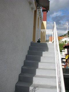 stairs from garden to apartment door
