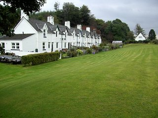 The playing green in front of the cottages