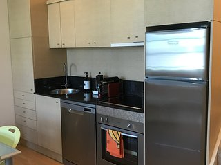 Fully Equipped Kitchen with Granite Benchtop, Dishwasher, Microwave, Toaster, Etc.