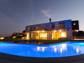 house and swimming pool at night