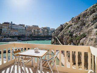 Luxury seafront apartment in quaint seaside village