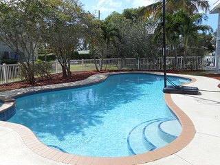 Private Tropical Paradise in Holmes Beach!  Large home with Pool and fenced yard