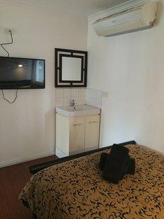 Bedroom1 reverse cycle air con, vanity mirror TV