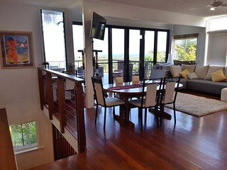 Living, (extended) dining, view and deck.  Kitchen is here too (out of shot)
