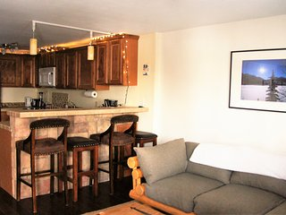 The lounge area leads into the kitchen, which has bar seating for four.