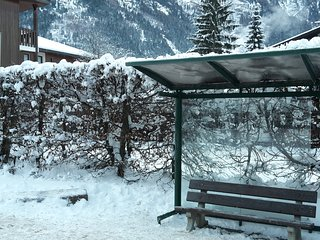 Bus stop (line 1 from Les Houches to Grands Montets)  right outside the building.