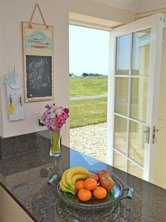 The bright and airy kitchen opens out onto the garden