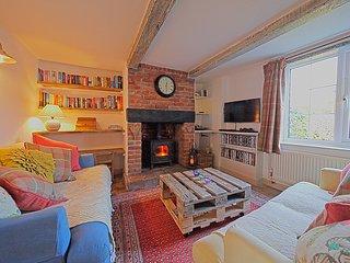 The living room had a log burner for the cooler months