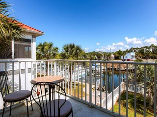 Enjoy canal views, a dock, shared pool access - walk to beach, snowbirds welcome, Mexico Beach