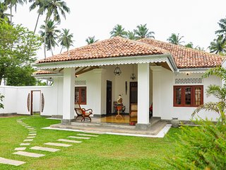 Our 100 year old renovated antique House sits comfortably in its own walled tropical garden.