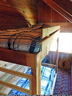 An old porch was converted to a bunk room.  It is off of the Queen bedroom