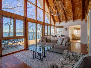Remodeled waterfront home with a wrap-around deck, water views & beach access!