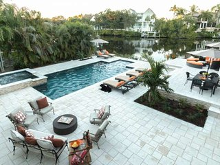 Professionally Decorated Waterfront Home w/htd.pool,spa, dock- less than 2 miles